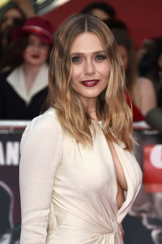 elizabeth olsen boobs show at an event