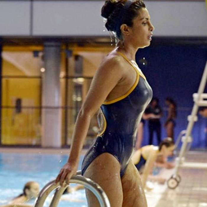 Priyanka Chopra posing aside pool in sexy black swimsuit