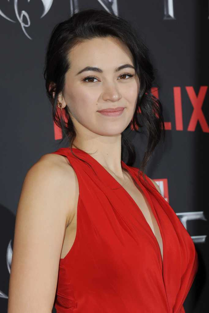 Jessica Henwick sexy boobs show in red dress at an event